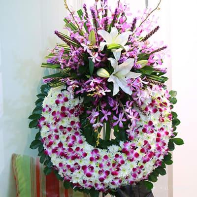 Funeral wreath purple & white