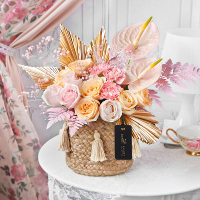 Pastel Petals in Jute Basket for Mother