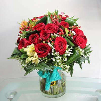 Red roses & seasonal flowers in vase