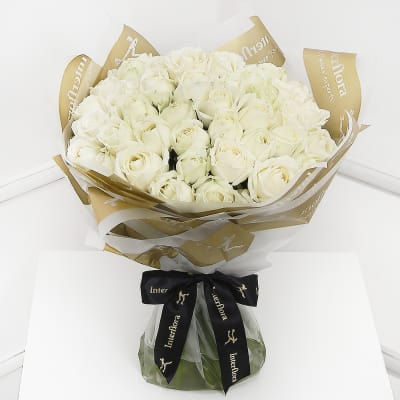 White flowers send white flowers online in india same day delivery ultimate 100 white roses hand tied mightylinksfo