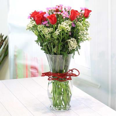 Vase of roses & seasonal flowers