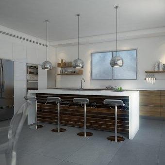 אי במטבח מעץ ושיש לבן עם שלוש מנורות עגולות תלויות מהתיקרה