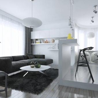 """הסלון והמטבח מחוברים, כאשר ההפרדה נוצרת ע""""י האי והבמה המגביהה את אזור המטבח"""