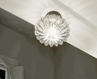 מנורת תקרה צמודה BELL היא מנורה עשויה מבנה מתכתי עם בד 100% פוליאסטר ב10 צבעים שונים.  המנורה מתאימה מאוד לפרויקטים שונים שכן אפשר להזמין אותה במימדי ענק על פי דרישת לקוח.  ניתן להזמין את המנורה על פי דרישה גם עם אלומת אור עליונה.  המנורה היא חלק ממשפחה של מנורות תקרה תלויה ומנורות קיר.  הגדרה: כללי  צורה: אובלי  פנים \ חוץ: פנים  סוג התקנה: צמוד  שם מוצר: BELL  חברה: AXO LIGHT  עיצוב: