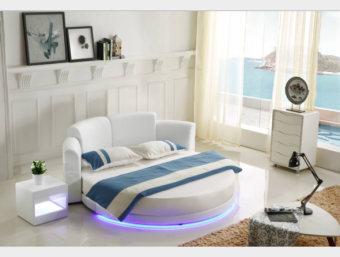 """C016  מיטה זוגית עגולה מרופדת מדמוי עור איכותי מסוג PU בשילוב עור  עם תאורת לד דקורטיבית המעניקה למיטה מראה יוקרתי וקלאסי.   ניתן לרכוש בכל צבע לבחירתכם.   מידת מיטה תואמת למזרן 2.0*2.0:  אורך- 240 ס""""מ  רוחב- 220 ס""""מ  גובה- 90 ס""""מ   מפרט טכני:   שלדת המיטה עשויה עץ גושני   ציפוי המיטה עשוי ספוג איכותי המעניק למיטה תחושת רכות   ריפוד המיטה עשוי מדמוי עור איכותי מסוג PU בשילוב עור   בסיס המיטה עשוי מברזל ולוחות סנדוויץ'   *כחלק משקיפות ואמינות החברה, אין חברתנו דורשת כל תוספת תשלום בעבור שינוי גודל המיטה לכל אחת מהמידות הבאות: 140*190 , 140*200, 160*190, 160*200 , 180*200   *המחיר המוצג לעיל הינו עבור המתואר בפירוט ואינו כולל מוצרים נלווים (כגון: שידות, מזרנים, הדומים ומזרנים).   הוראות טיפול ברהיטי עור ודמוי עור:      1.יש להרחיק את המוצר ממקורות חום ישירים,כגון: שמש ,תנורים, וגופי חימום.      2.יש להימנע ממגע ממושך של המוצר עם מים ו/או כל נוזל אחר      3.בעת ניקוי המוצר יש להשתמש במטלית לחה ורכה ומיד לייבש במטלית יבשה.      4.לניקוי יסודי יש להשתמש בתכשירי ניקוי המיועדים לעור אשר אינם מכילים אלכוהול"""