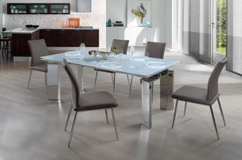 """שולחן אוכל מזכוכית + 6 כסאות דגם הלנה פינת אוכל מזכוכית הבנוייה מהחומרים הטובים ביותר ועמידה לשנים. שולחן זכוכית מלבני הנפתח ל- 300 ס""""מ. פלטת השולחן זכוכית חלבית במראה ייחודי. המערכת כוללת 6 כסאות אוכל מרופדים עם רגלי ניקל, בקווים נקיים ומודרניים. ריפוד הכסאות חזק במיוחד ומצטיין בניקוי קל ומהיר. לשולחן 2 הגדלות של 50 ס""""מ. מידות השולחן: אורך: 200 ס""""מ, רוחב: 100 ס""""מ. נפתחת ל- 300 ס""""מ. (הכסאות שמופיעים בתמונה אינם במלאי, ניתן לבחור בין הכסאות המופיעים למטה) דגמי כסאות לבחירה: המחיר הינו לשולחן + 6 כסאות מרופדים . המחיר נכון ל- 12 תשלומים ללא ריבית בכרטיס אשראי."""
