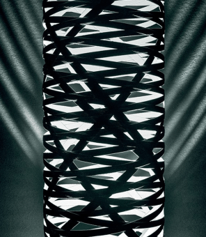 Floor lamp with diffused and indirect light. The fibreglass-based composite material diffuser is produced by modelling tape along a mould with an automatic control of the pitch/pattern, which is then epoxy powder coated. The large version features two separate light sources: one is located at the upper tip of the diffuser, and the other inside the diffuser; upper parabola made of aluminium. The transparent cable is fitted with a dimmer which can be used both to adjust the level of luminous intensity of the upper light source gradually or as the ON/ OFF switch for the lower light source. In the medium version: single light source in the base inside the diffuser; the dimmer fitted on the transparent cable can be used both to adjust the level of luminous intensity gradually as well as an ON/OFF switch