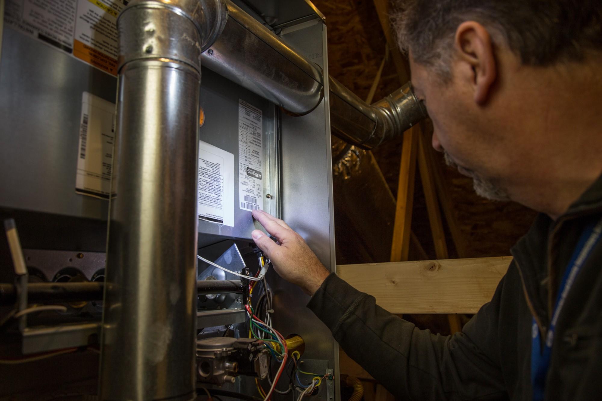 Attic furnace inspection.