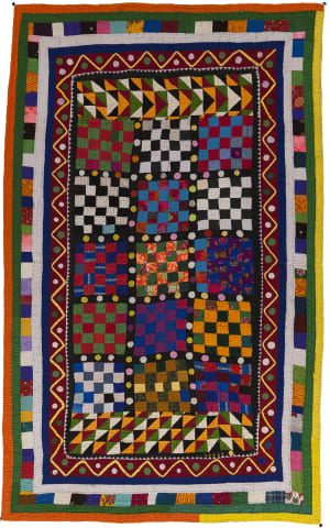 A brightly colored Dharki or quilt made in India.