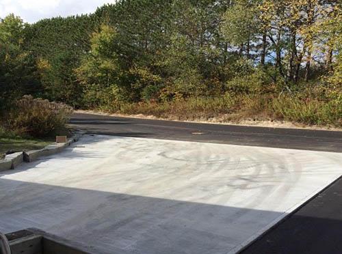 New Concrete Pad and Asphalt Pavement