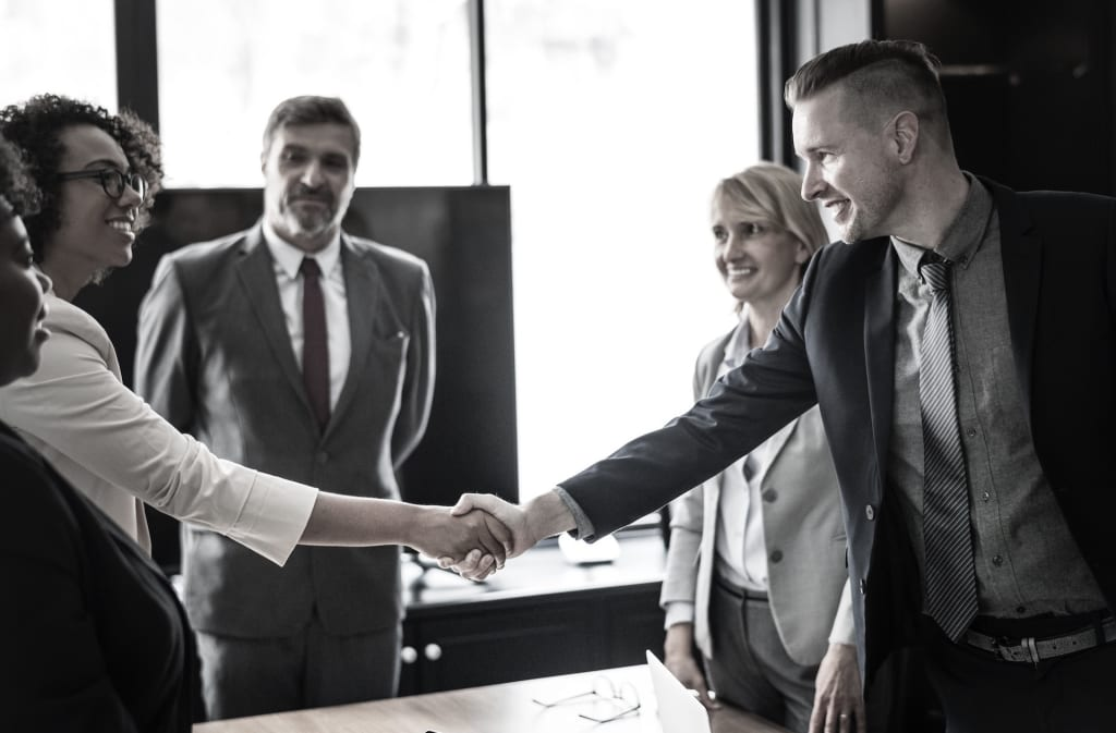 two business partners close a deal with a handshake