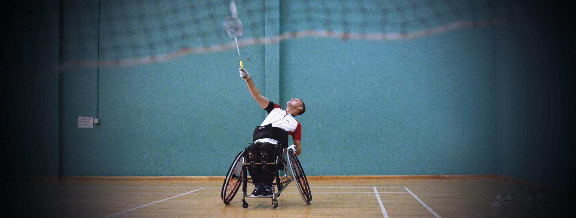 Man playing wheelchair badminton