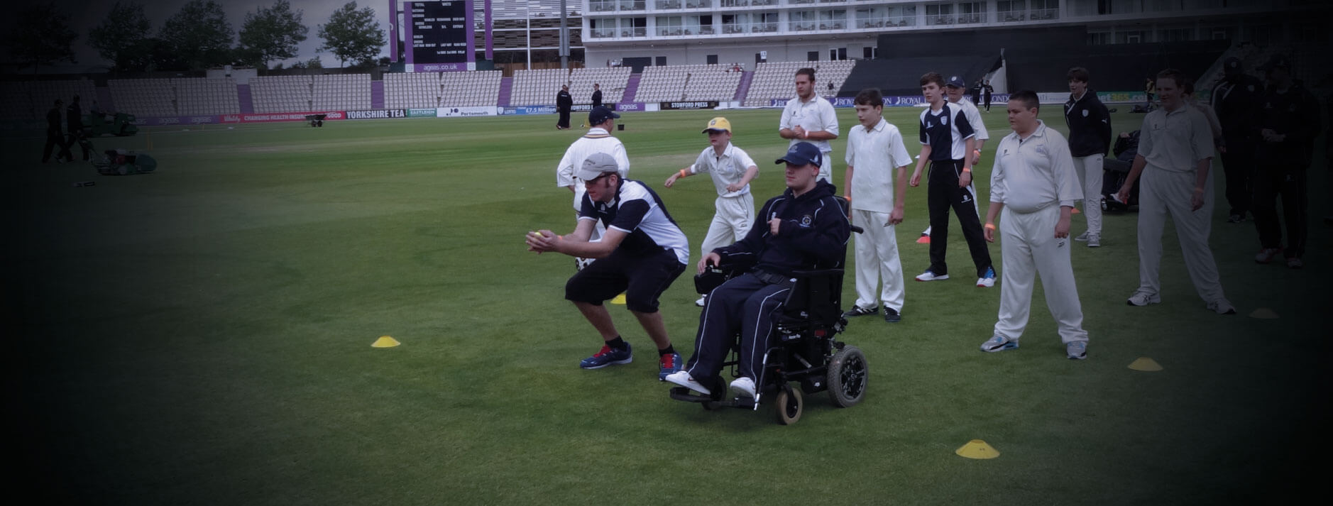 Man in wheelchair playing cricket