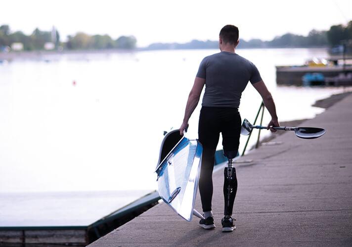 man carrying canoe