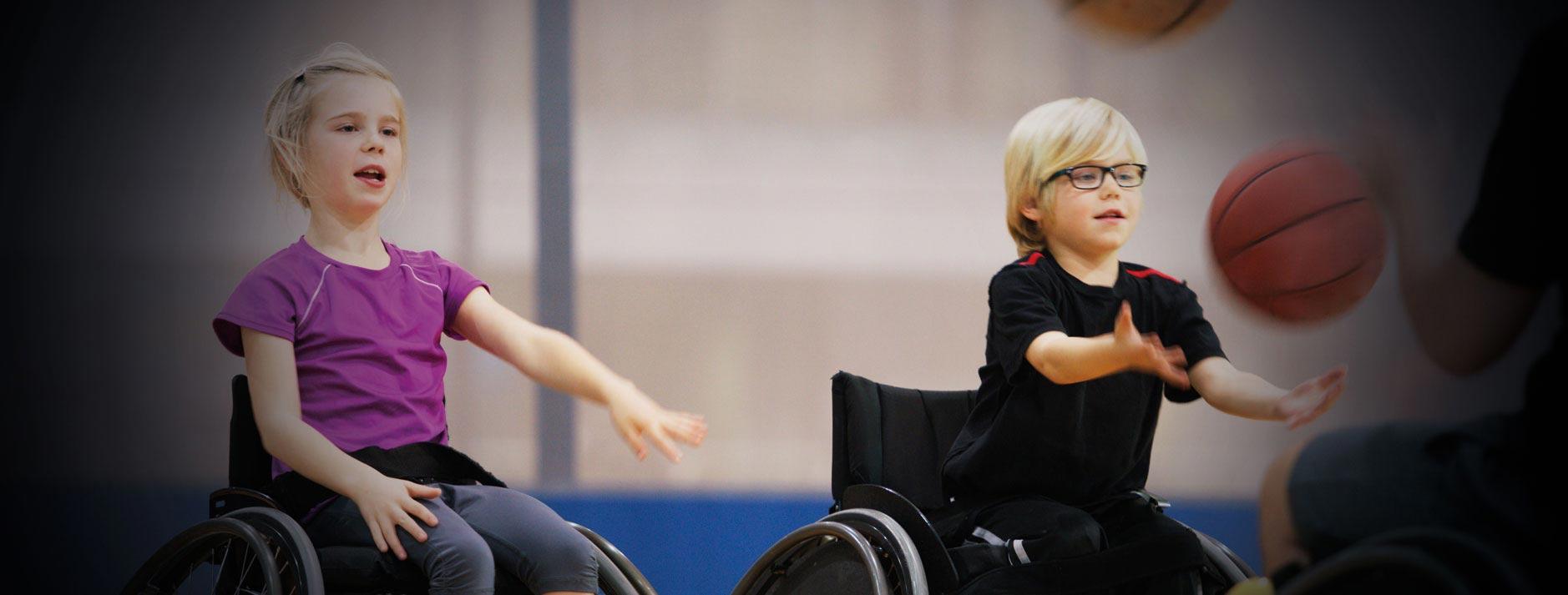Kids playing wheelchair basketball