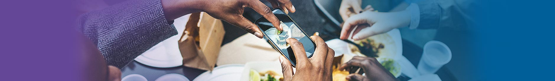 Man taking picture of food with smart phone