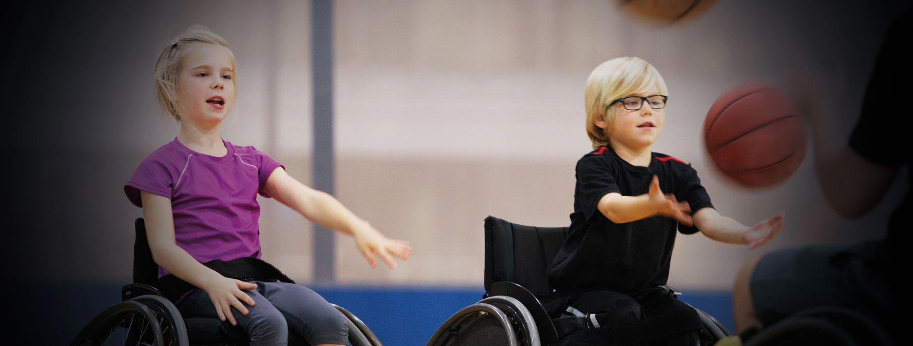 Kids playing wheelchair basketball