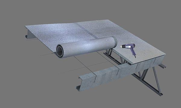 Se presenta el rollo de Doble Alu en el mismo sentido que las chapas de la cubierta. Se coloca el segundo rollo paralelo al primero superponiendo los solapes para hacer la unión por termosoldado sobre la estrutura.