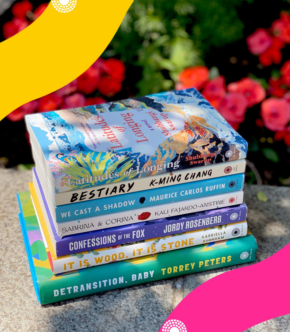 Photograph of stack of books with fun color blocks overlaid in corners and One World logo in white on bottom.
