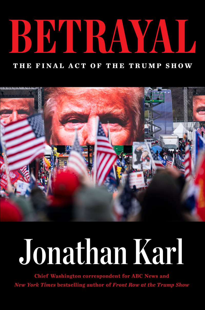 The cover of Jon Karl's BETRAYAL is on a black hardcover book, featuring photos of former president Trump in the background while flags wave in the foreground.