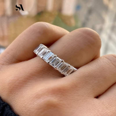 emerald diamond eternity band in white gold on finger