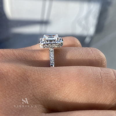 Emerald Cut Diamond Engagement Ring on finger