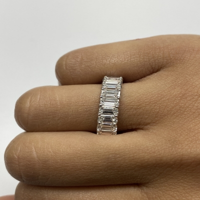 emerald cut eternity band double prong on finger