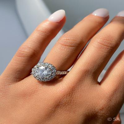 round diamond halo engagement ring on finger