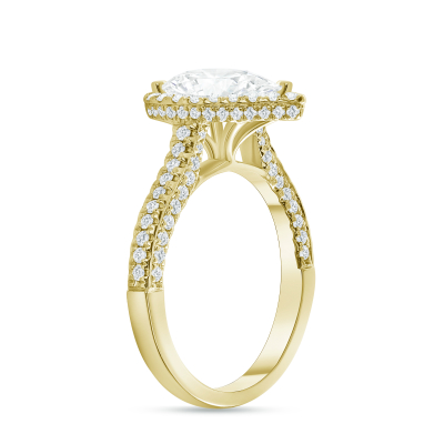large pear shaped & small round diamond engagement ring yellow gold