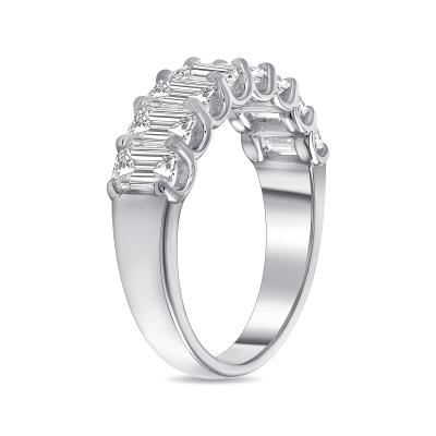 emerald half eternity ring white gold
