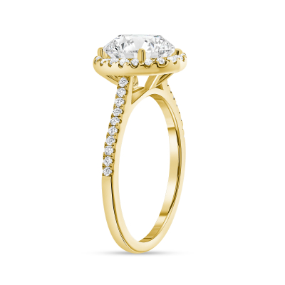 classic oval cut diamond halo engagement ring yellow gold