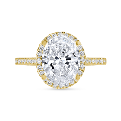 oval cut diamond halo engagement ring with prongs yellow gold