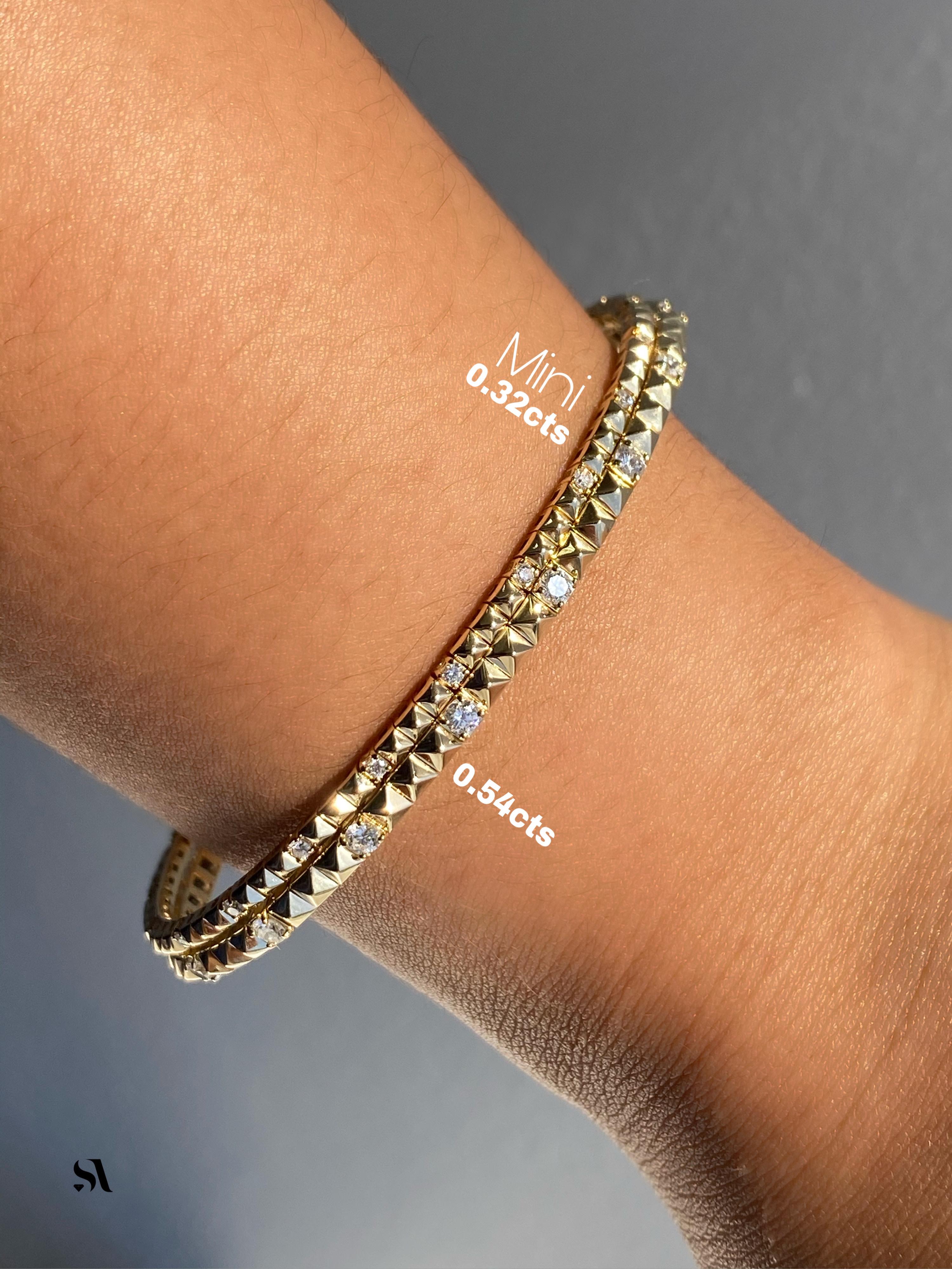 14k pyramid bracelet shown wearing