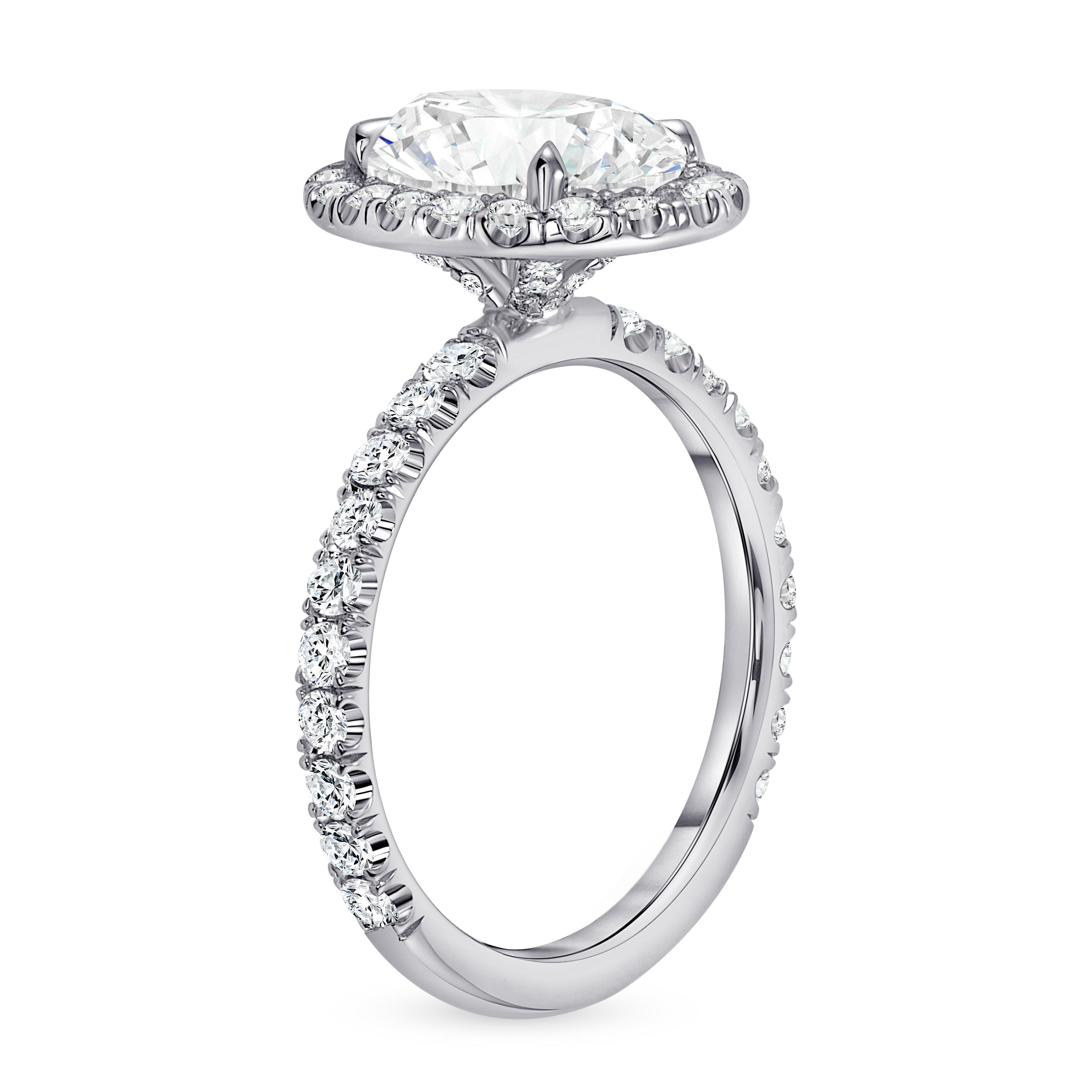 oval diamond halo engagement ring white gold