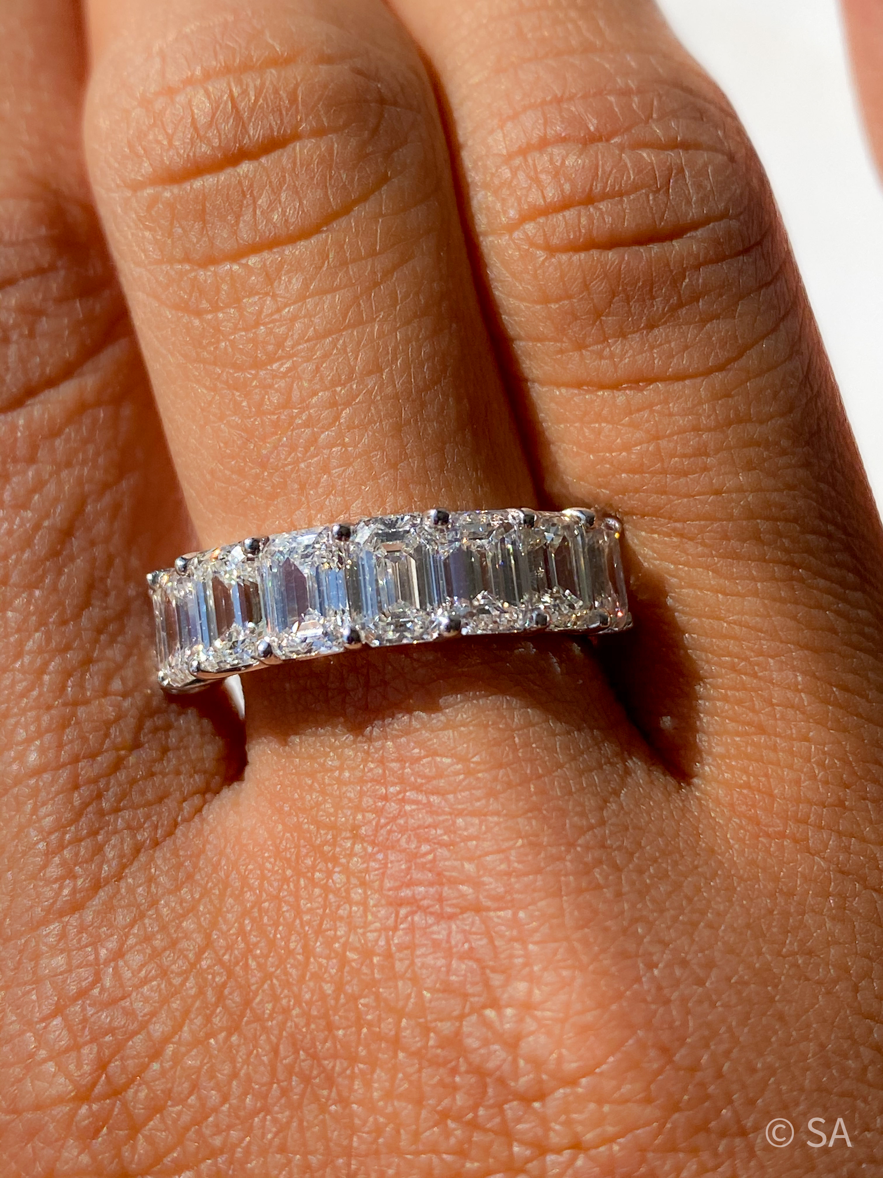 emerald cut diamond half eternity band platinum