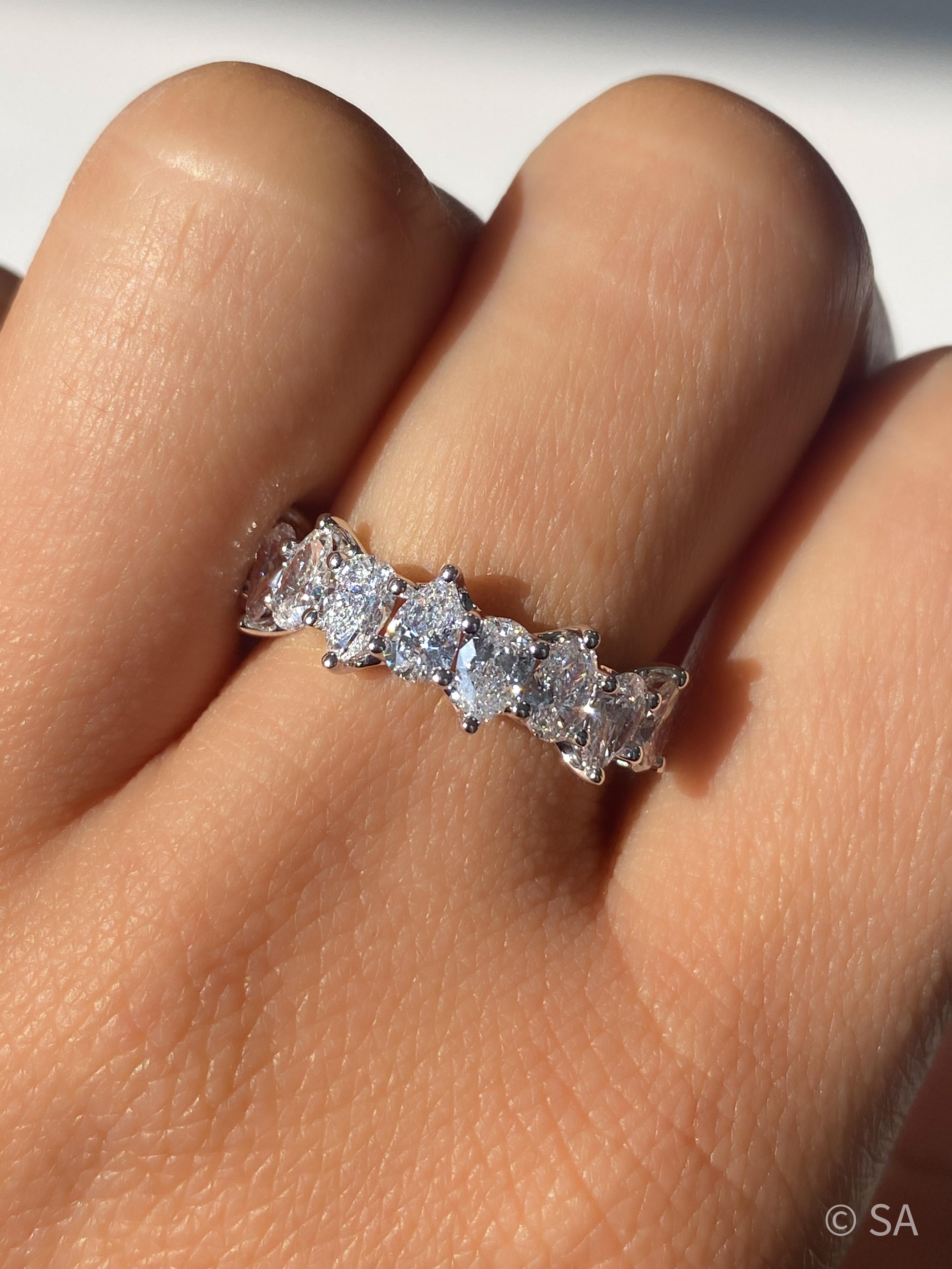 half eternity pear diamond band on finger