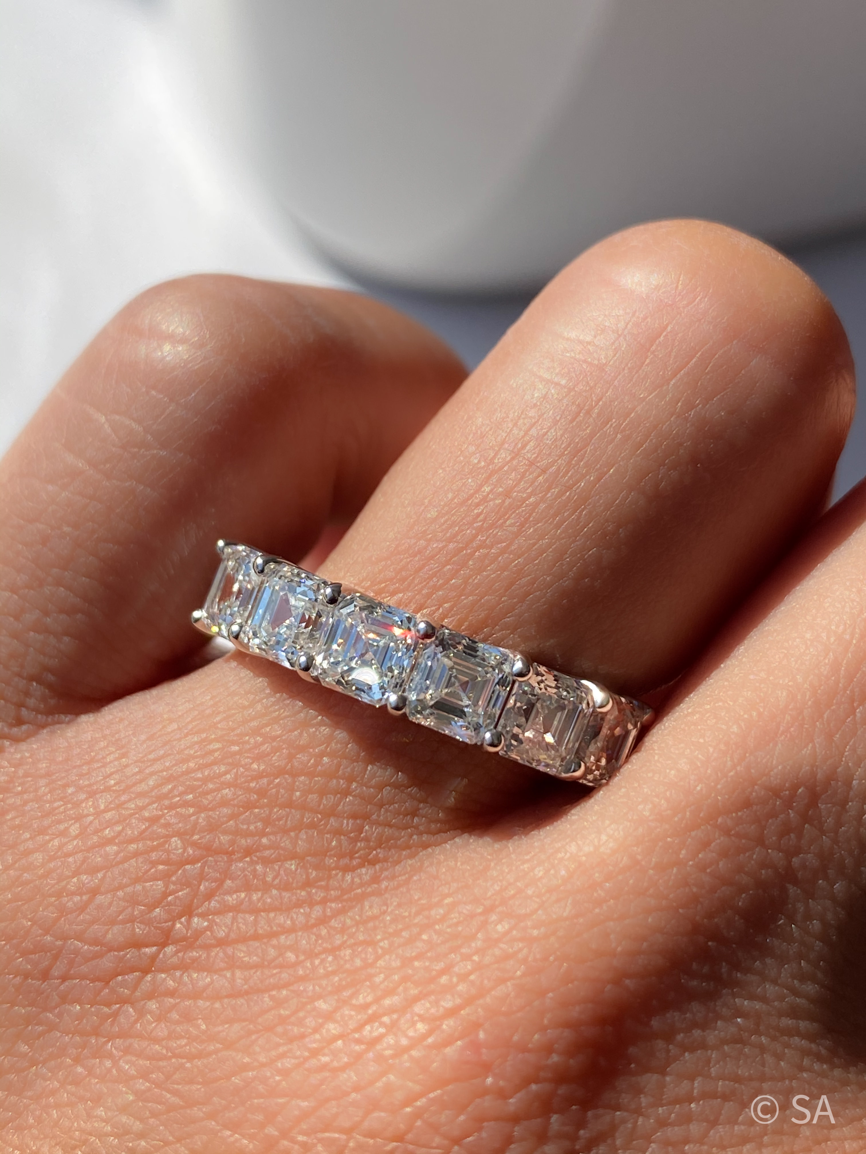 asscher diamond eternity band on finger