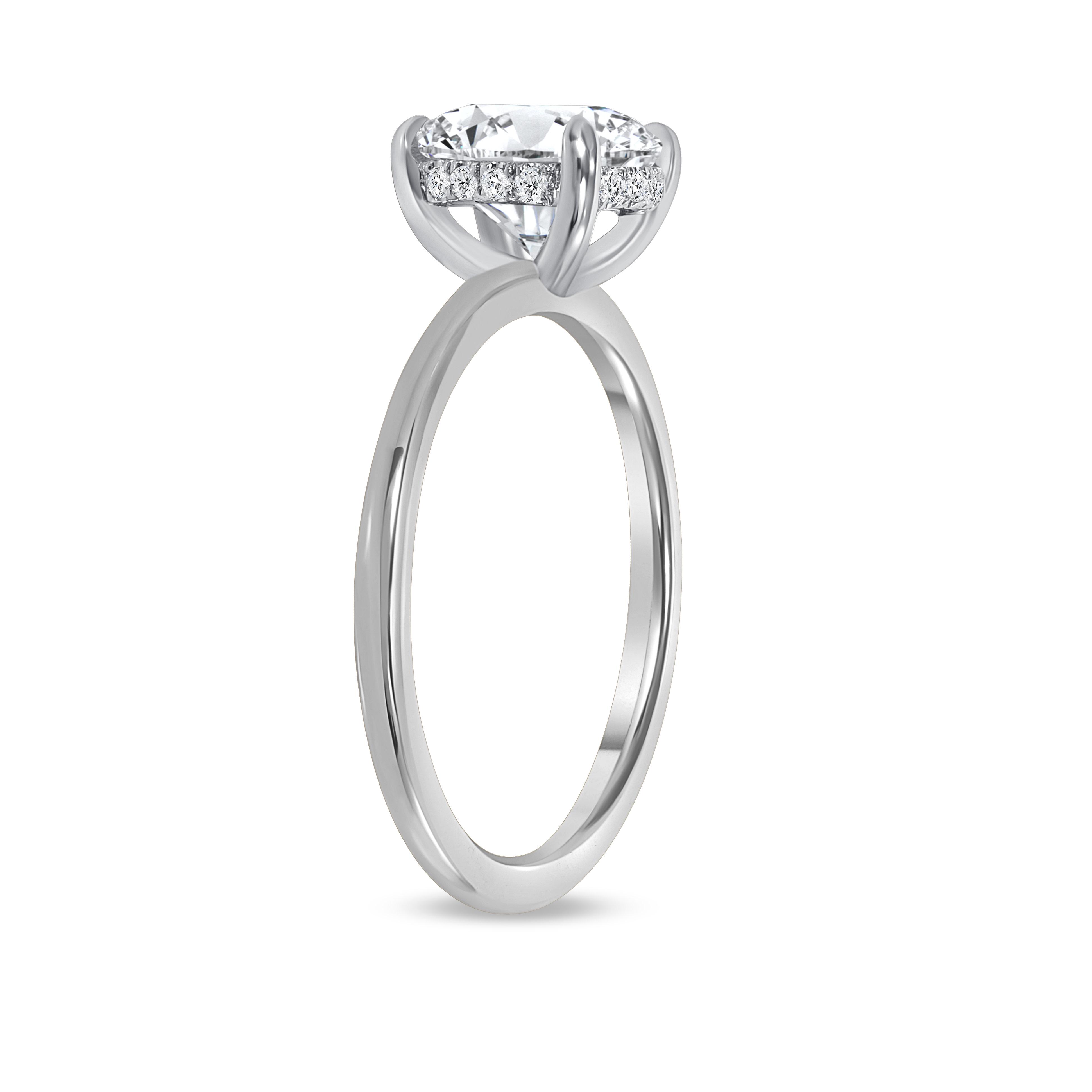 round hidden halo engagement ring white gold