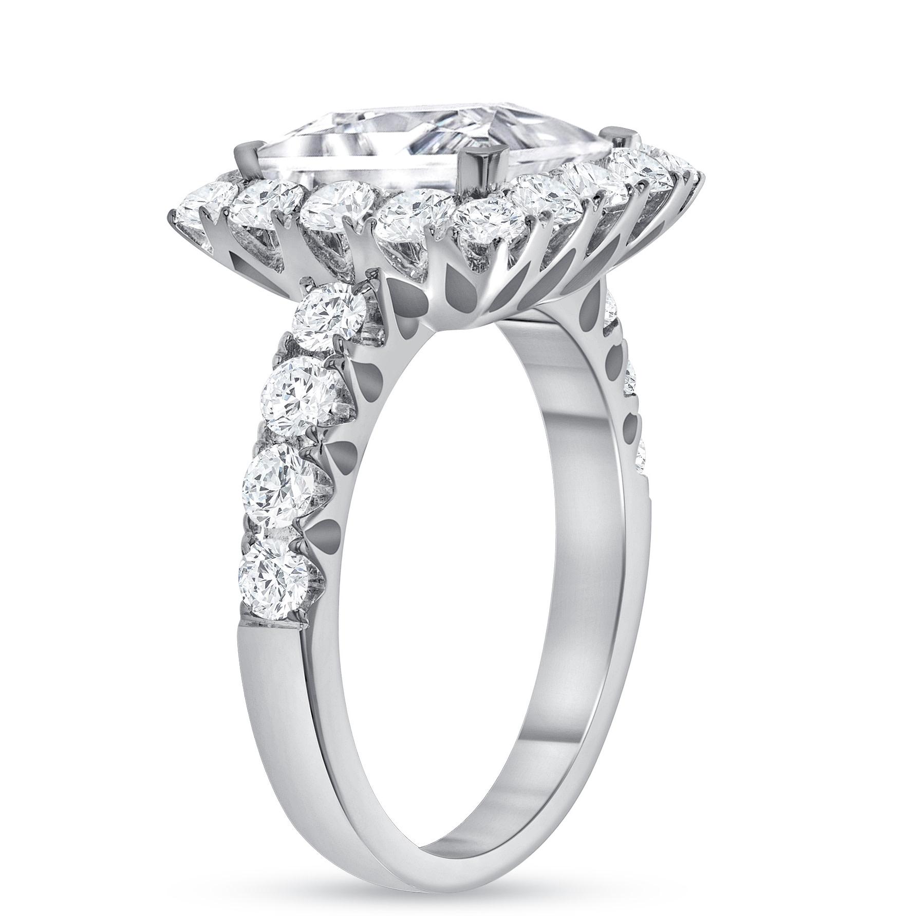 princess & round diamond engagement ring white gold