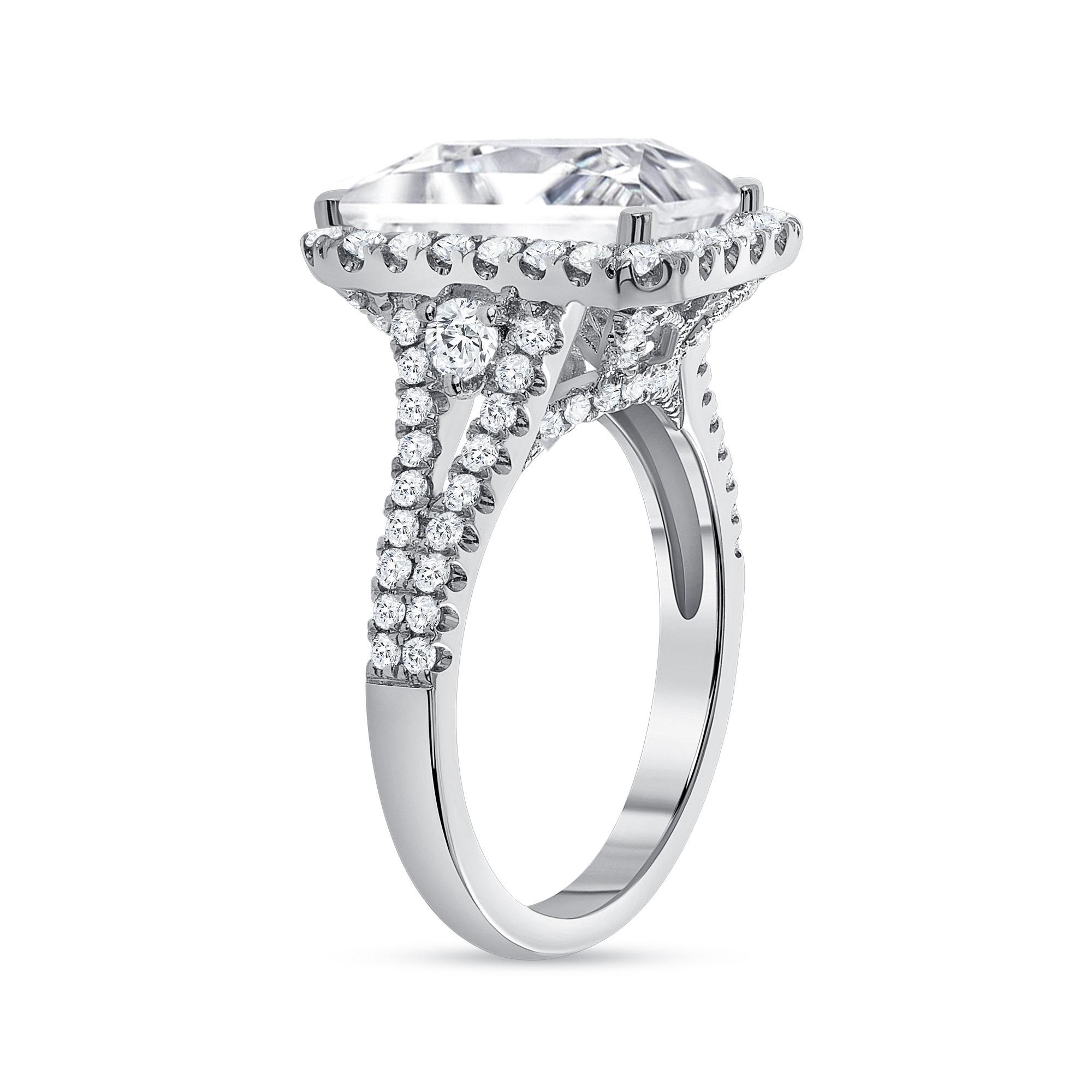 emerald & round diamond engagement ring white gold