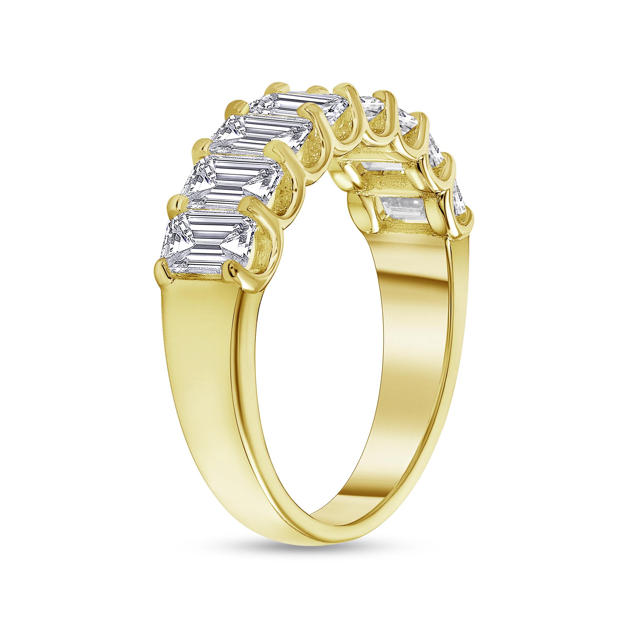 emerald half eternity ring gold