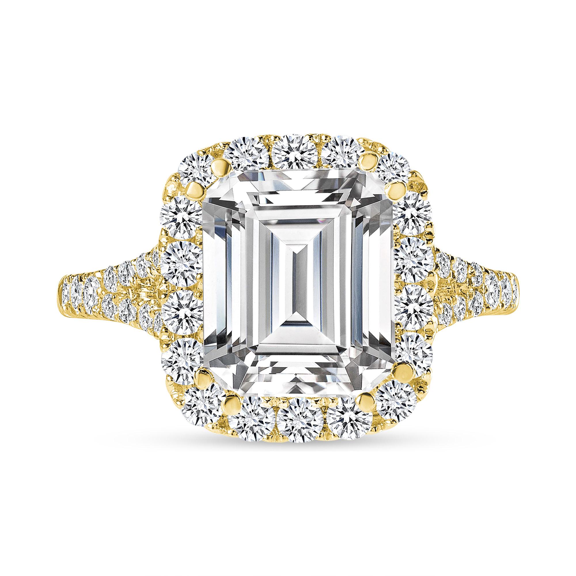 emerald cut diamond halo engagement ring yellow gold