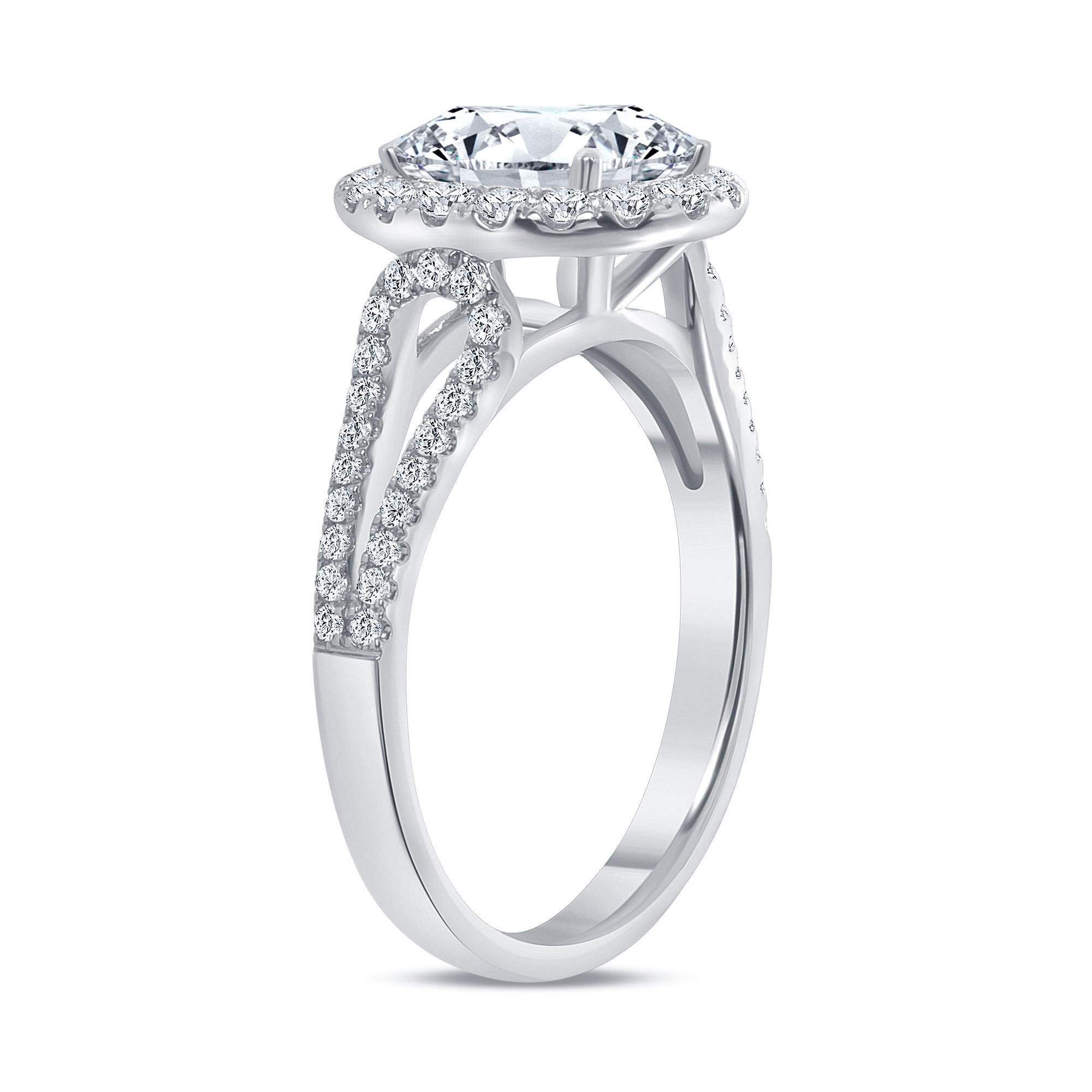 oval diamond halo split shank engagement ring white gold
