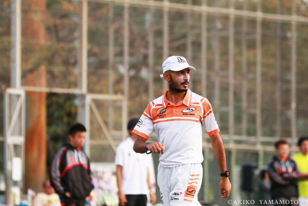 Photo of me refereeing Touch football in Japan.