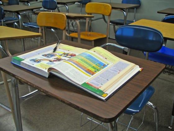 School Desk with Textbook by Cameron Cross via Shutterstock.com