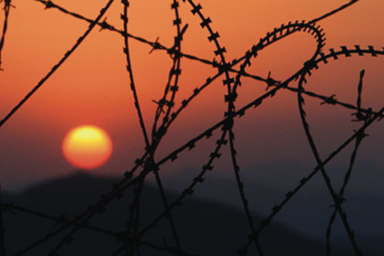 Sun sets over DMZ in North Korea // credit: JoongAng Ilbo