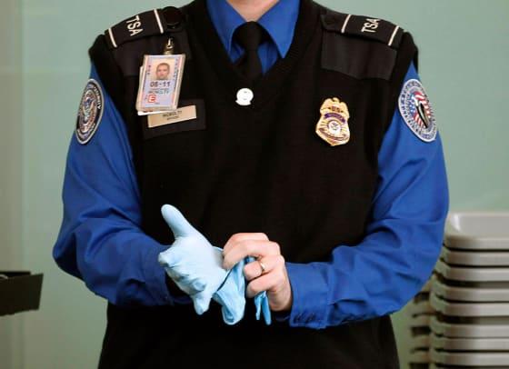 tsa-agent-putting-on-search-glove
