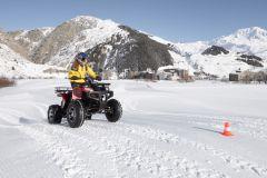 E-Quad Riding On Swiss Snow