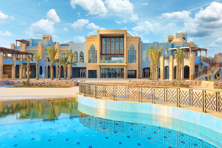 Lazuli Marsa Alam Hotel - Building facade with pool - daytime - Mohamed Abdel-Hady Photography