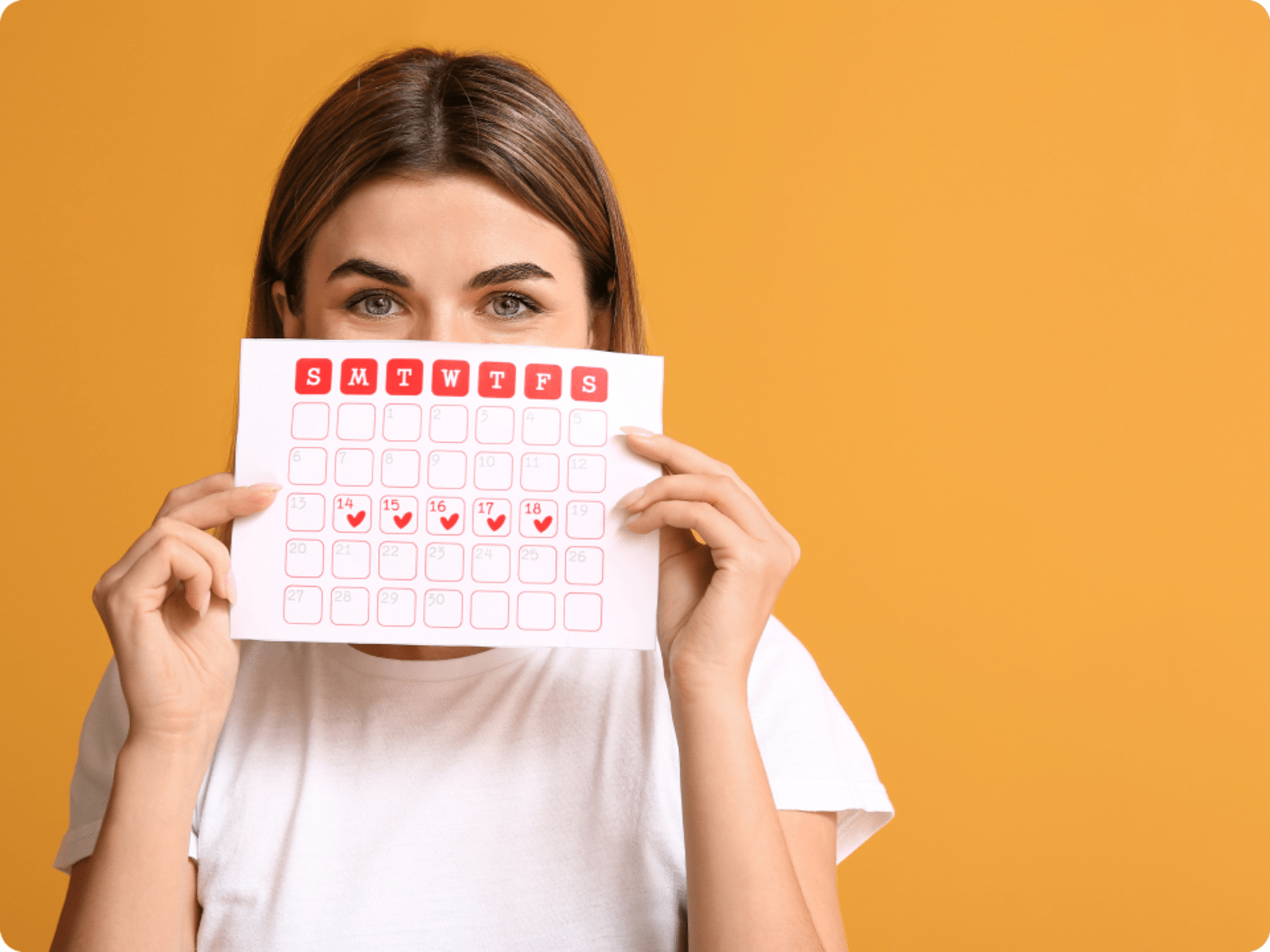 Young woman with menstrual calendar